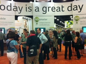 Sage Summit attendees congregating around the Sage Intelligence booth.