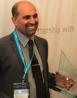 Visionary CIO 2013, Sal Laher, with his trophy. Photograph by Dylan Mohlala.