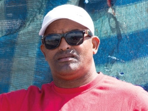 Sulaiman Arnold, owns a fruit and veg stall and a snoek stand.
