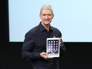 Apple CEO Tim Cook holds an iPad during a presentation at Apple's headquarters in California yesterday.