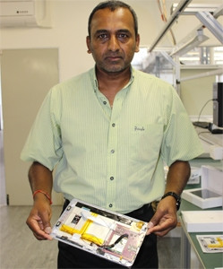 CZ Electronics CEO Sagran Pillay with one of the semi-assembled tablets that will go into production next month.