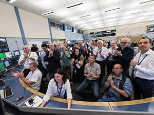 Scientists celebrate the kick-off of the second run of the Large Hadron Collider.