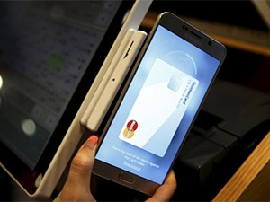 Samsung Pay allows customers to pay for goods by placing their handsets on or next to a point-of-sale terminal.