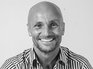 Lowered costs are the main reason why SMEs opt for hot-desking, says The Extension's Simon Campbell-Young.