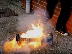 """Stephen Leenott's """"hoverboard"""" caught alight when he tried to ride it (screenshot from video)."""