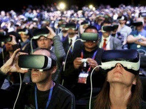Thousands at the MWC Samsung Unpacked event donned Samsung Gear VR devices to experience the ceremony in virtual reality. (Photograph by Reuters)