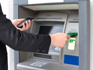 Japan police suspect a group of more than 100 people extracted money from ATMs in Tokyo and 16 prefectures.