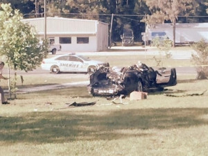 The aftermath of the Tesla vehicle crash.