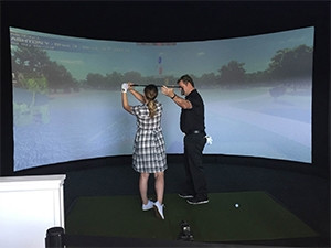Amateur players could practice their swing, hitting into a simulation screen powered by About Golf.