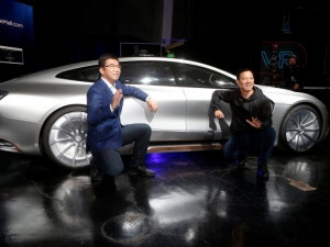LeEco CEO and founder YT Jia and co-founder and global vice-chairman Lei Ding pose in front of a LeSEE car during a press event in San Francisco.