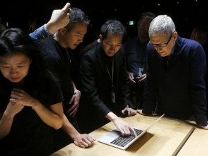 Apple CEO Tim Cook with the new MacBook Pro after a media event in California.