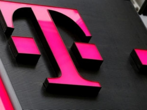 T-Mobile could be involved in a tie-up with Sprint, or be acquired by a cable company, says JP Morgan.