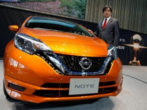 Nissan executive VP Hideyuki Sakamoto with the hybrid version of Nissan Note.