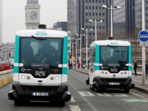 Two self-driving electric minibuses in Paris, France.
