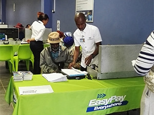 A social grant recipient registers for the EasyPay green card at a Net1 office in Bizana.