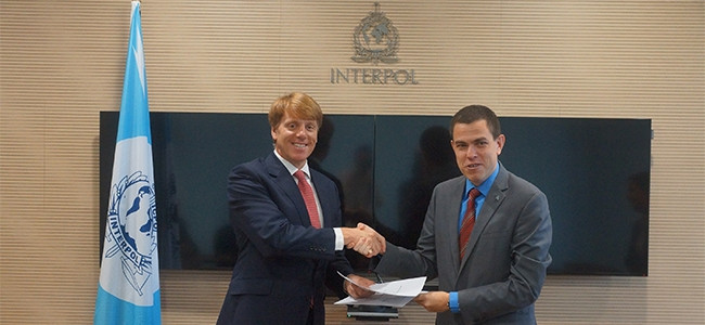 Mark Hughes, CEO of BT Security, and Silvino Schlickmann, director of the cyber crime directorate at Interpol.