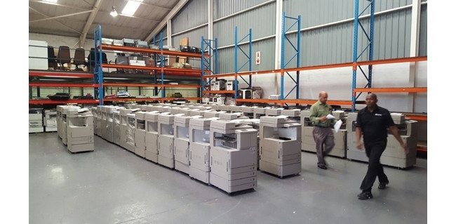 Refurbished Canon copiers at our warehouse.