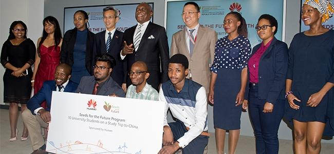 Minister Siyabonga Cwele flanked by China's ambassador to SA and this year's Seeds for the Future students.