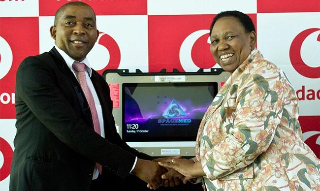 Basic education minister Angie Motshekga and Vodacom's Vuyani Jarana. (Photo by Brian Ngobese)