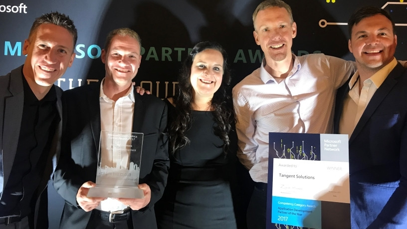 Dave Nel, Andre du Toit, Natalie Brunsdon, Cliff de Wit and Ruaan Erasmus from Tangent Solutions receive the Application Development Partner of the Year award, during the Microsoft 2017 Partner Awards held at Sandton Convention Centre.