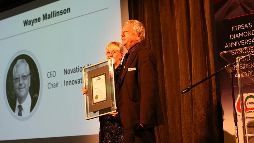 Wayne Mallinson receiving the IITPSA Fellowship Award from Moira de Roche.