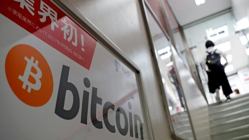 Bitcoin's rise has been fuelled by signs the digital currency is gaining traction in the mainstream investment world.
