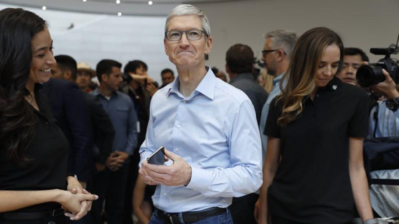 Tim Cook, CEO of Apple, demonstrates an iPhone.