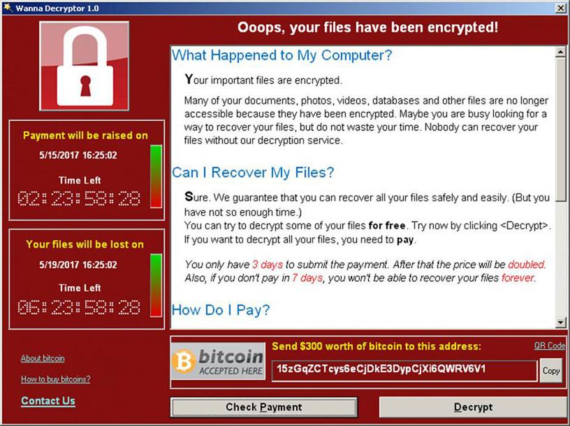 A screenshot shows a WannaCry ransomware demand.