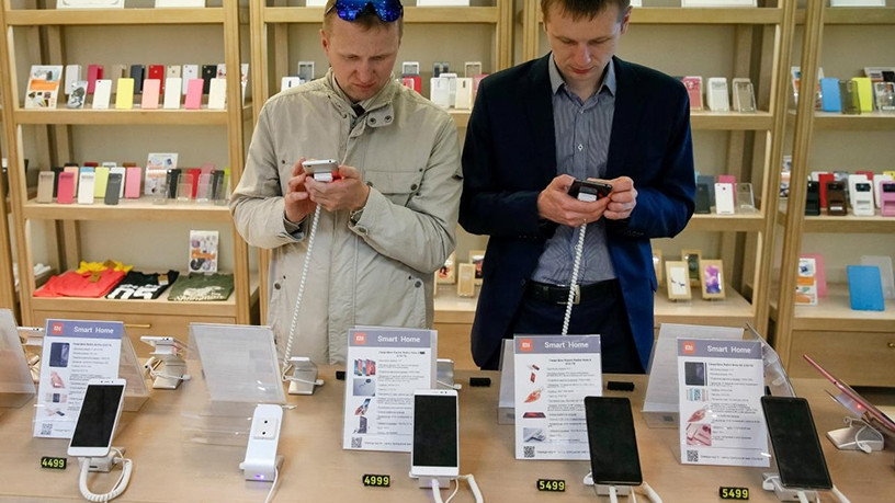 Customers try out Xiaomi smartphones at a store in the Ukraine.