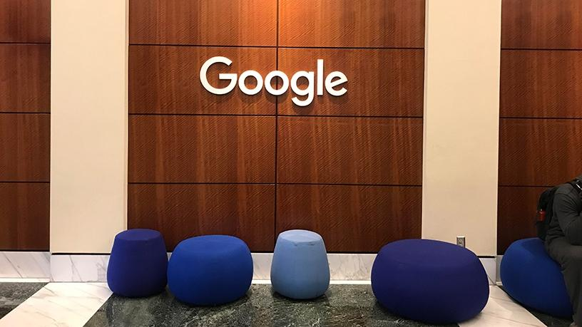 The welcome hallway with Google Home-shaped ottomans.