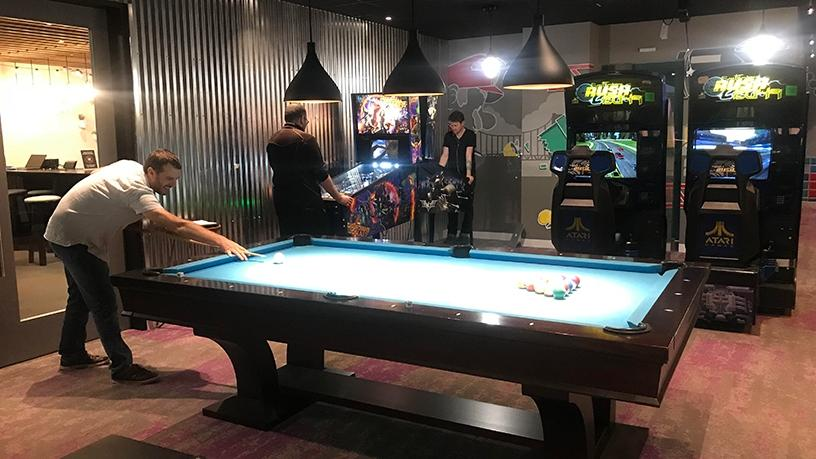 The Google games room has a foosball table, arcade games and a pool table.