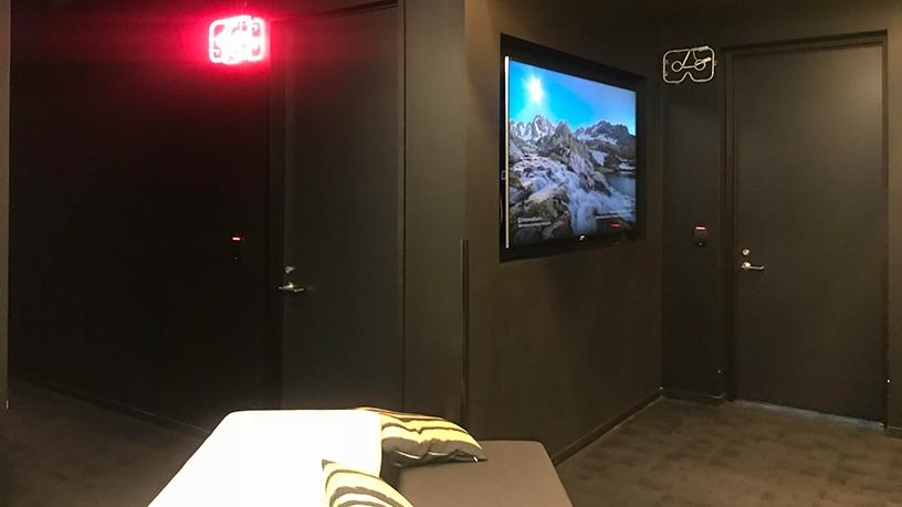 A series of audio visual rooms set up for viewing media in virtual reality.