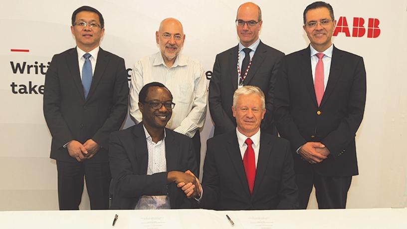 Dr. Chunyuan Gu, Professor Barry Dwolatzky, Claudio Facchin and Sami Atiya. Front row: Professor Tawana Kupe and Leon Viljoen.