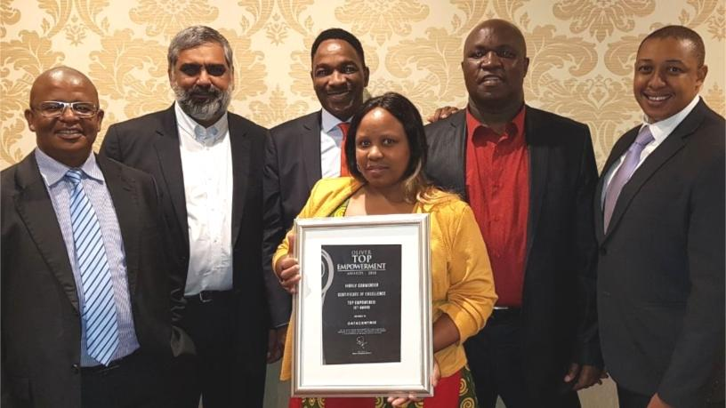 From L-R: Moses Segaetsho -  CIO at Auditor General SA, Ahmed Mahomed - Datacentrix CEO, Kenny Nkosi -  Divisional MD Public Sector at Datacentrix, Dr. Stanley Mpofu - WITS CIO, Tumi Pooe - Datacentrix Public Sector Business Unit Manager, and Mrs. Ntombi Mpofu - wife of WITS CIO (holding award).