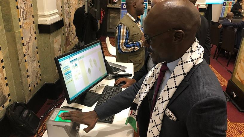 Minister Malusi Gigaba tries out the identification system at the launch event yesterday. (Photo source: SA Government News)