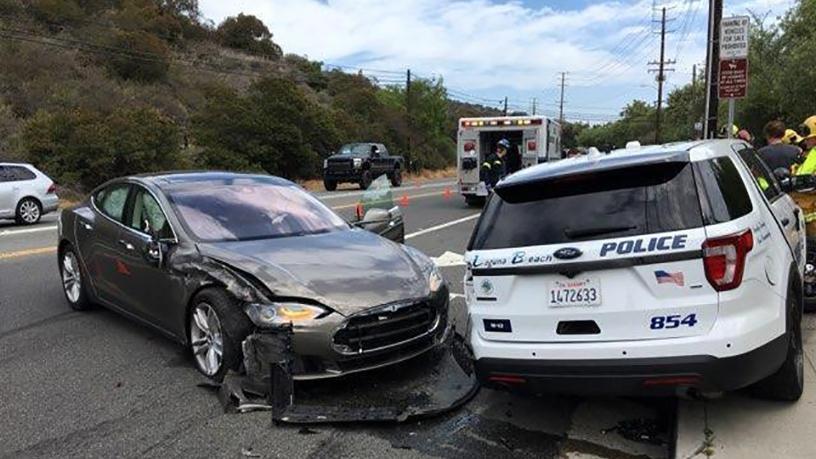 The Tesla sedan after it struck a parked police car.