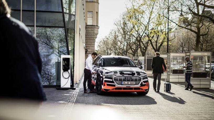 Charging the Audi e-tron vehicle.