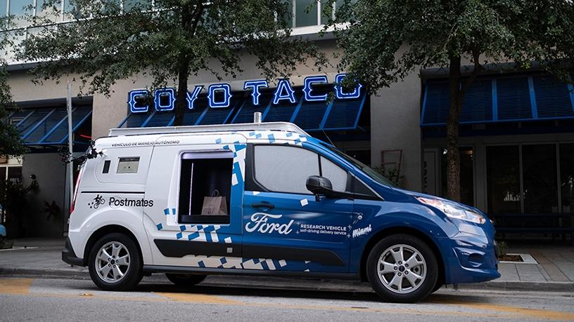 Ford's self-driving delivery vehicle features lockers for food and goods pick-up.