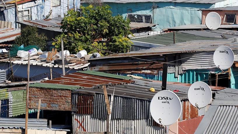 Satellite dishes connect Khayelitsha to the DSTV television network.