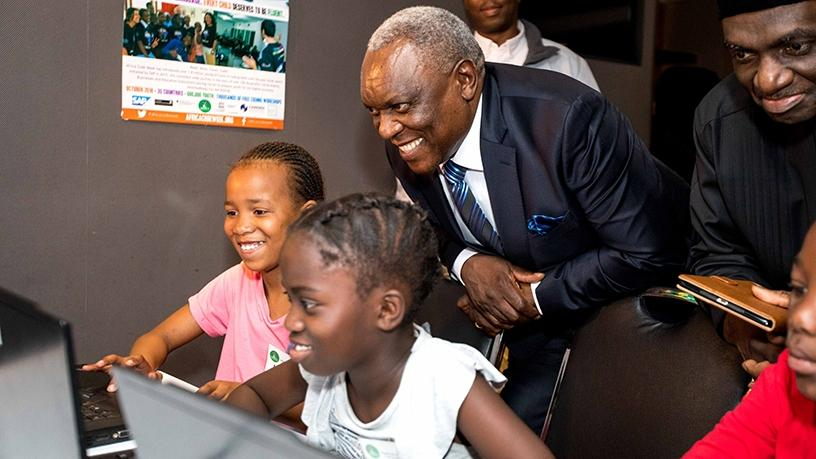 Minister Siyabonga Cwele engages school children at the SAP Africa Code Week launch in Johannesburg.