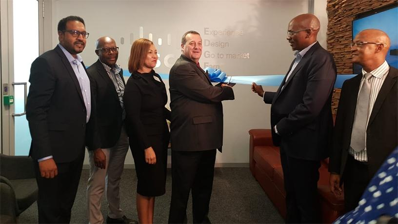 Executives from Cisco, The Innovation Hub and SITA officially unveil the Edge Incubation Centre.